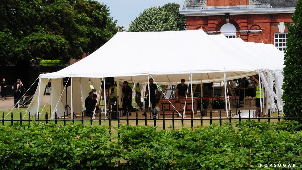Talk about a wedding fit for a princess! Nicky Hilton is tying the knot with her fiancé, James Rothschild, at Kensington Palace — the home of Prince William and Kate Middleton. Preparations began early on Friday as tents were set up and decorations were brought to the grounds. A source confirmed to People that Nicky's wedding will take place in The Orangery, which is located in the Kensington Gardens.  Originally built for Queen Anne's orange trees in the early 18th century, The Orangery is regularly open to visitors for breakfast, lunch, and afternoon tea. Nicky's wedding isn't the only special ceremony to take place there, either; according to the venue's website, The Orangery is generally available to book for parties and events.  The Duke and Duchess of Cambridge are currently residing at Anmer Hall, their country home and a gift from Queen Elizabeth II. They recently celebrated a special ceremony of their own, with the royal family gathering for Princess Charlotte's picture-perfect christening. Keep reading to see pictures of all the preparations at Kensington Palace, then check out photos from Nicky Hilton and James Rothschild's prewedding dinner on Thursday.