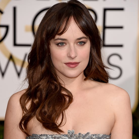 Dakota Johnson In Grey Chanel Dress at 2015 Golden Globes