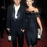 Kate wears a black knee-length dress with an ostrich feather trim to Frank Sinatra's 80th birthday in 1995.