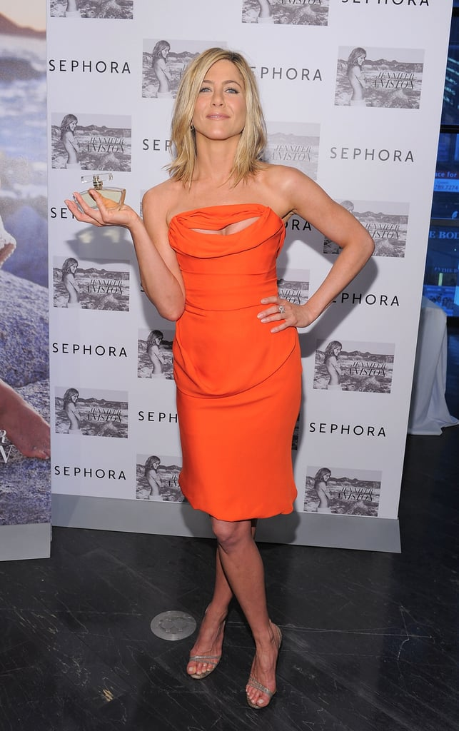 Jennifer Aniston Is Red-Hot in a Cleavage-Baring Dress For Her Perfume Signing