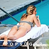 Kristin Cavallari lounged by an LA pool in June and wore a striped bikini.