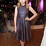Chloe Moretz arrived at the CinemaCon awards ceremony wearing a purple metallic Kenzo dress.