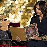 Michelle Obama's golden sleeves matched Miss Piggy's sparkly dress.