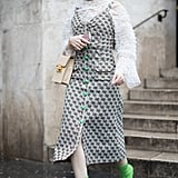 Style Your White Eyelet Top With a Floral Dress and Sock Boots