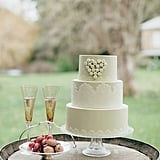 Hearts and lace —does it get any girlier than that? We love the sweet touch this cake adds to the reception.  Photo by Eon Images via Style Me Pretty