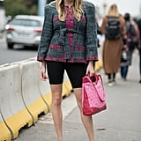 Cycling shorts are ultraflattering when worn with heels and a blazer belted to show off your waist.