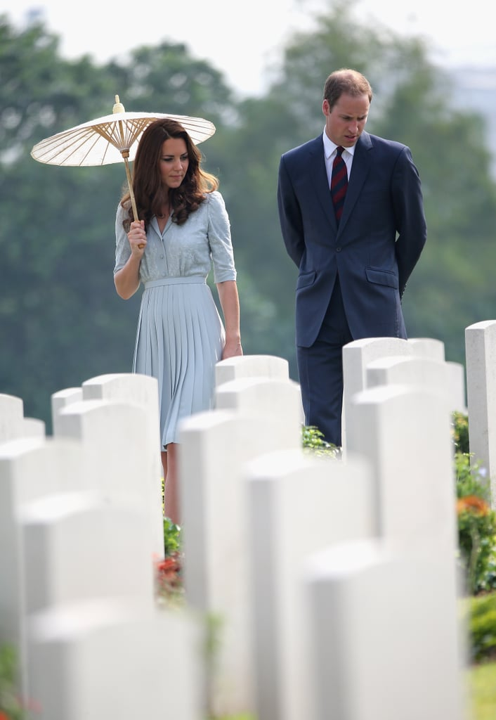Kate Middleton toted a parasol through the Kranji War Memorial with Prince William.