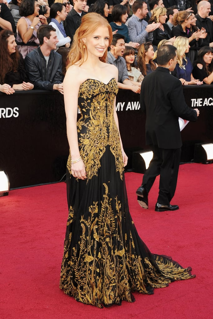 Jessica Chastain wore a strapless Alexander McQueen gown to this evening's Academy Awards in LA. She complemented the gown with $2 million of Harry Winston diamonds! It's Jessica's first time attending the ceremony as a nominee, and she even brought her grandmother along as her date! She's up for a best supporting actress honor for The Help! Jessica shares the accolade with her costar Octavia Spencer, who will also be at this evening's show. The Help's in the running for best picture with eight other movies. What do you think of Jessica's long hair and gown combo? Make sure to weigh in on all of the evening's looks in our love it or hate it polls!