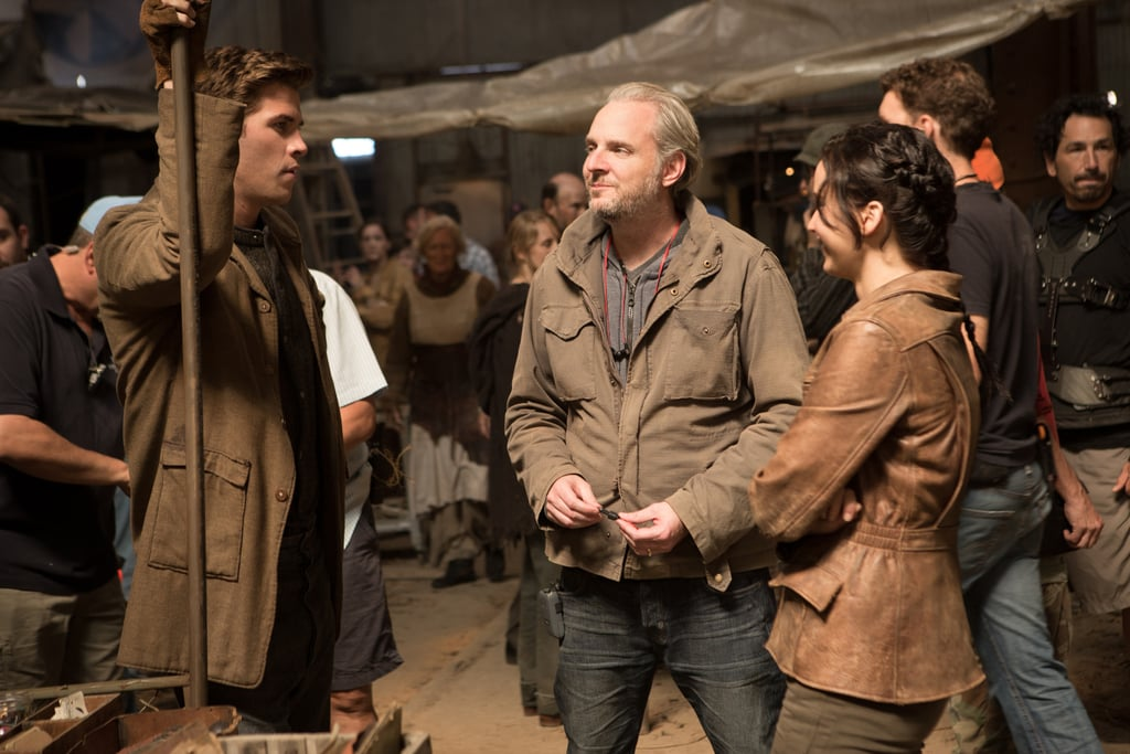 Liam Hemsworth and Jennifer Lawrence on the set of Catching Fire with director Francis Lawrence.