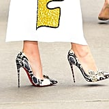 And she slipped into Christian Louboutin heels that came complete with a leopard bow.