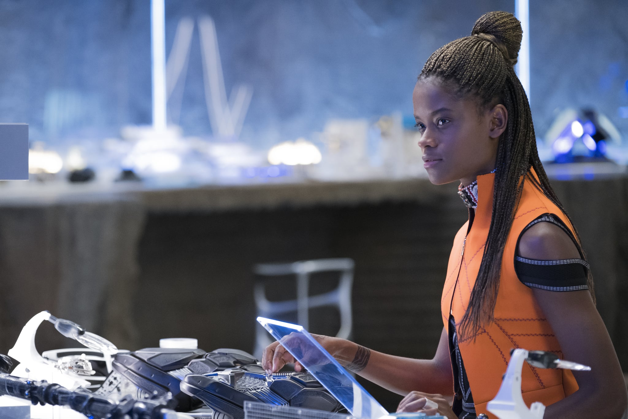 Shuri working on one of her gadgets.