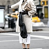 If you're going neutral up top, a pair of edgy heels will complete your look.