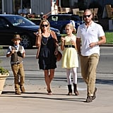The family of four chatted leaving Pinkberry.
