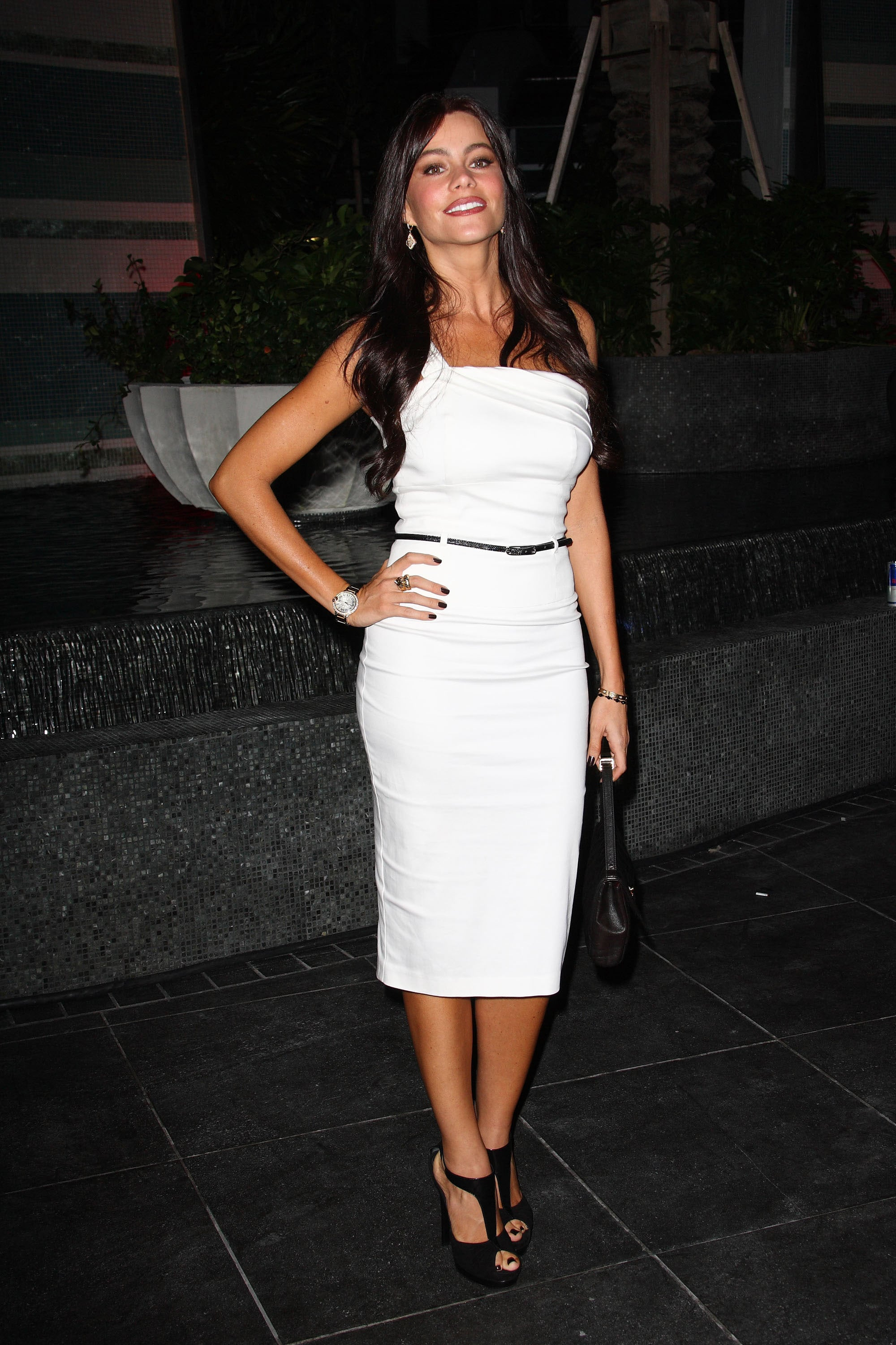 At the Fontainebleau Miami Beach grand opening, Sofia turned up the heat in a white, one-shouldered sheath dress and t-strap peep-toe pumps.