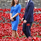 Kate's Dark Blue Clutch Matched William's Suit Amidst the Bright Poppies