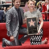 Scarlett Johansson and Jeremy Renner posed together with her new plaque.