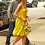 While Eva usually wears printed frocks, on this occasion she sported a solid yellow dress with Chloé wedges and a Stella McCartney clutch.