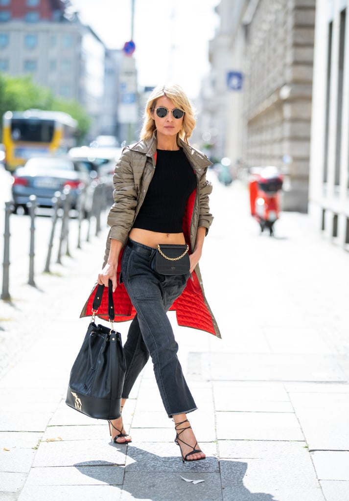 Style Low-Slung Cropped Jeans With Strappy Sandals, a Crop Top, and a Waist Bag