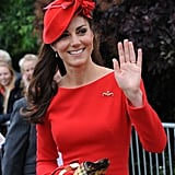Kate adorned her Alexander McQueen frock with a brooch and delicate earrings.
