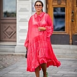 Styling a pink sheer dress with white undergarments.