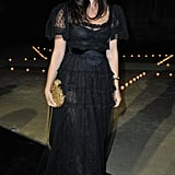 Julia Restoin Roitfeld chose a dramatic lace-overlay black dress for her mother's MAC party.