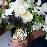 Have bridesmaids carry embellished bouquet wraps.