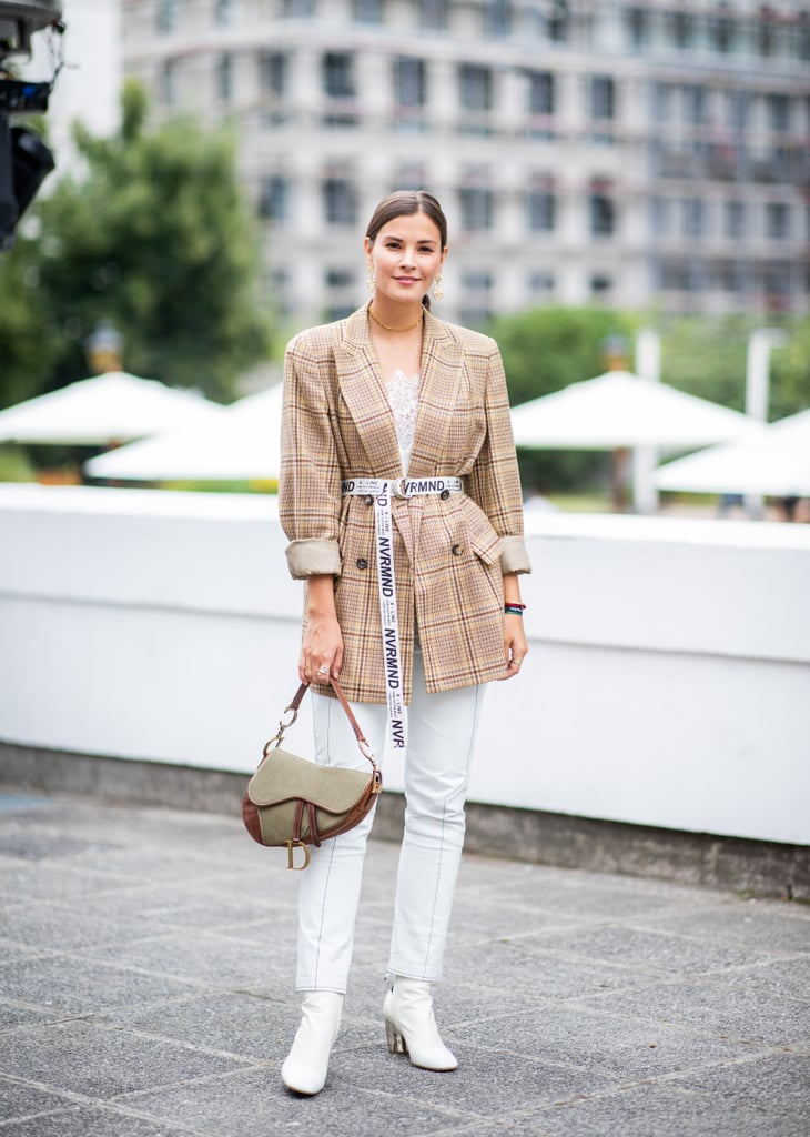 Belt a plaid blazer over white denim to take your light jeans into Fall and Winter.