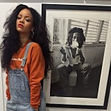 Rihanna posed in front of a photo of Bob Marley.