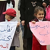 Jordanian women and kids held up signs protesting for the right of moms to pass on their nationality and citizenship to their children.