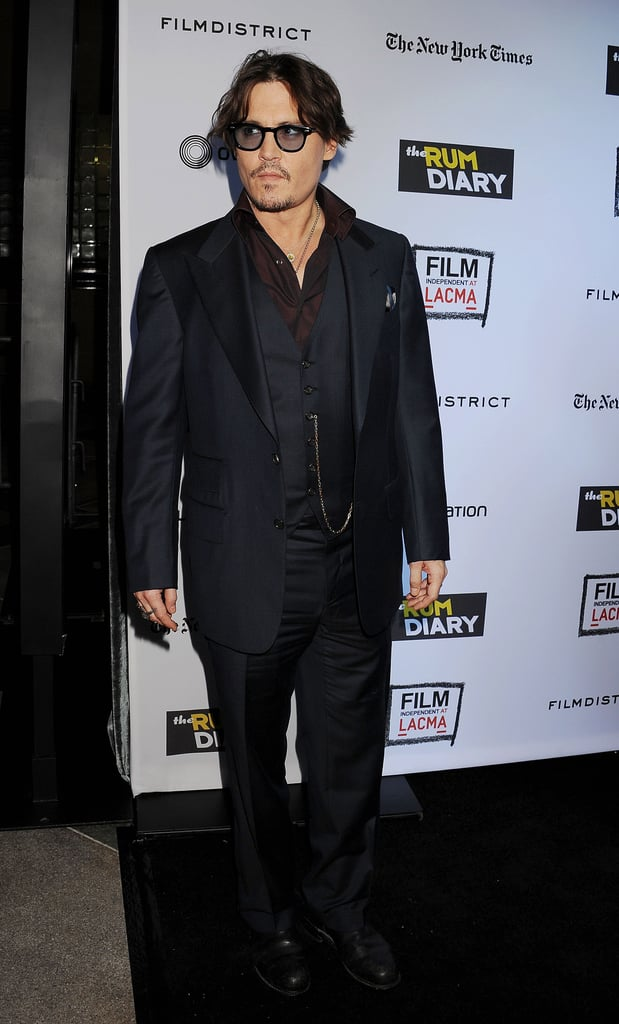 Johnny Depp walked into the premiere of his film The Rum Diary in LA.