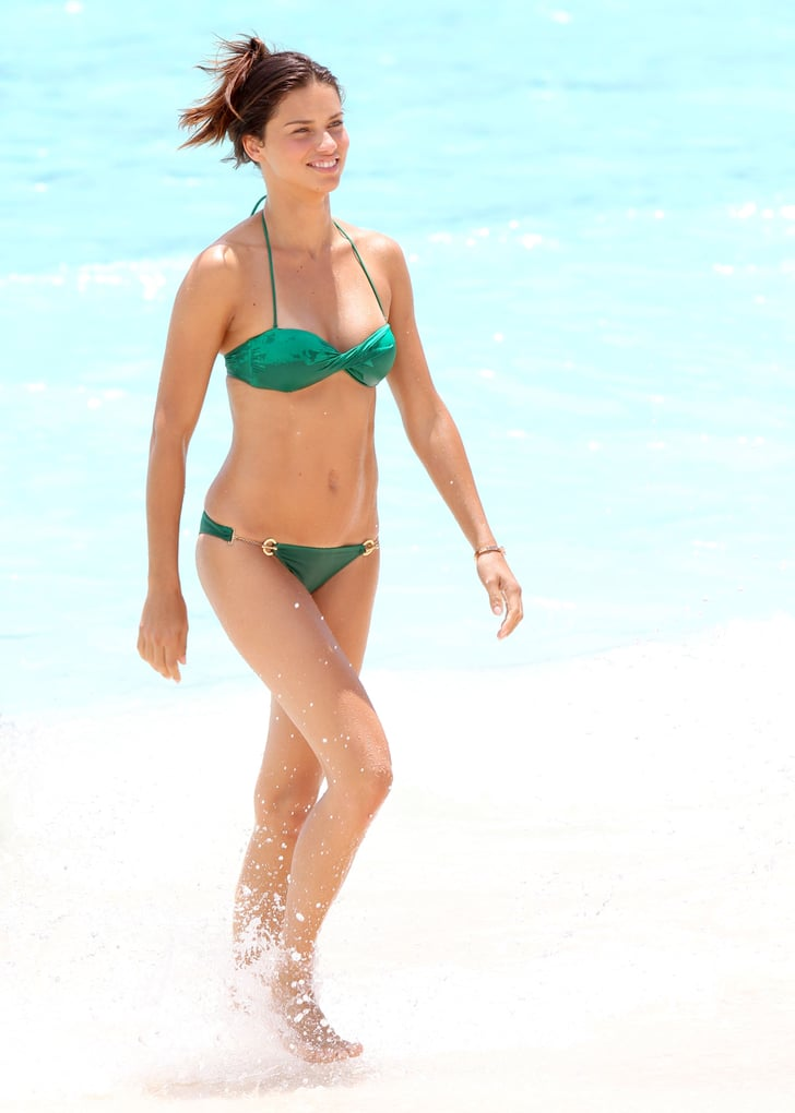 Adriana Lima splashed in the water during a St. Barts photo shoot for Victoria's Secret.