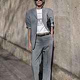Give your suit an achingly cool feel by styling with a t-shirt and sneakers.