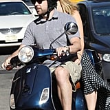 Olivia Wilde paired her dress and helmet with red Converse as she and Jason Sudeikis rode around NYC.