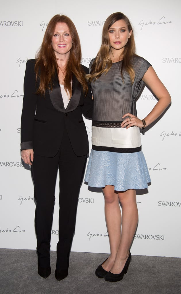 Fashion Week opens today in NYC, but the fun began with events last night. The Swarovski Celebration was just one bash, and it brought out Elizabeth Olsen and Julianne Moore. Elizabeth chose an Antonio Berardi dress while Julianne went with a simple black pantsuit. Elizabeth's gearing up for the release of Liberal Arts, which hits theaters Sept. 14, and posed with pink hair for Bullett Magazine to promote the project. She also appears in the September issue of Glamour magazine. There's plenty more action in store as Fashion's Night Out takes place this evening —we'll be covering the best parties and hottest stars so check back for updates!