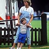 Playing with Prince William at a polo match, Diana donned light blue denim overalls featuring white straps, paired with a white buttoned tee and loafers.