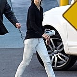 Swapping her signature dark denim for distressed gray skinny jeans in July 2009.