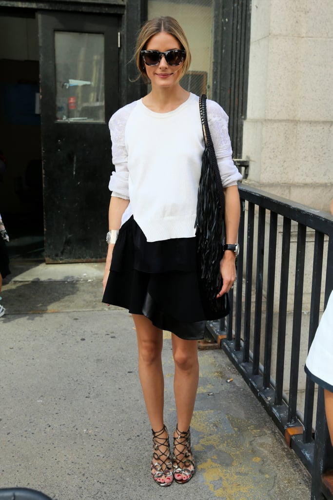 Olivia finished off her sporty and asymmetrical separates with glamorous accessories: oversize sunglasses and strappy Olivia Palermo x Aquazzura sandals.