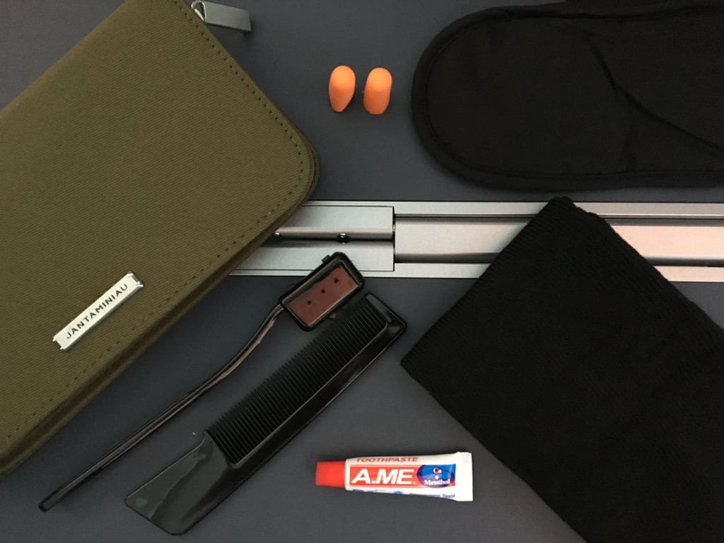 Inside the amenities bag, you'll get: a comb, toothbrush, toothpaste, earplugs, an eye mask, and socks. Perfect for settling into a long flight and in neutral colors so you can use it again.