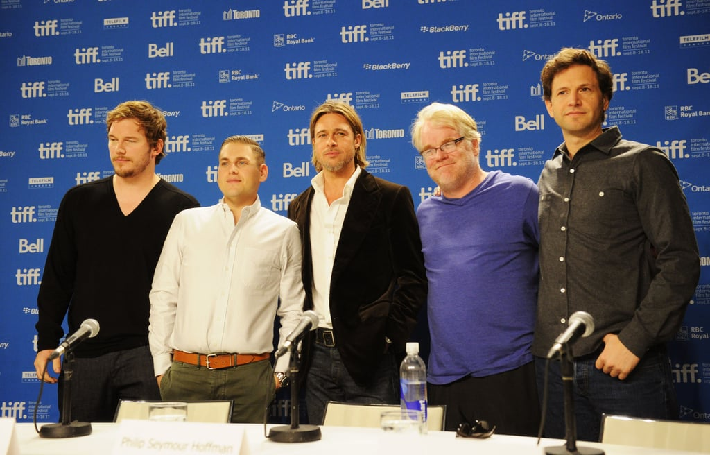 the cast of moneyball stood for a group picture