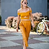 We're all about this matchy-matchy look. Wearing a crop top and high-waist pants in the same colour gives the illusion of a jumpsuit — with just a (surprise!) flash of skin.