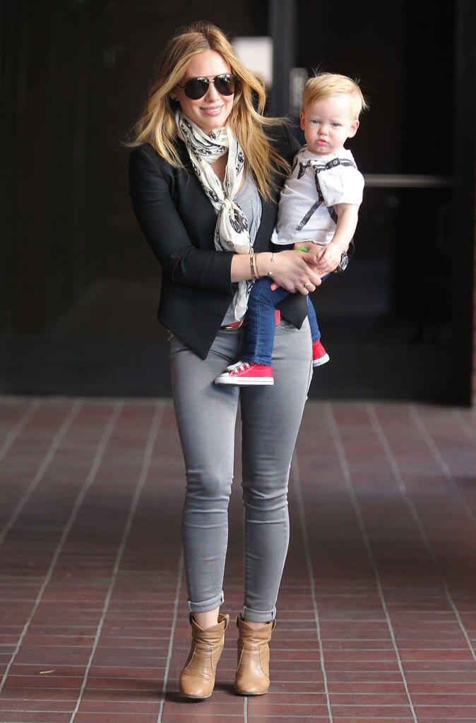 """Hilary Duff carried her son, Luca Comrie, to Babies First Class in LA yesterday. The active mom is back to running errands with Luca after traveling to Indio, CA, over the weekend with her husband, Mike Comrie, and older sister, Haylie Duff, for Coachella.  Fresh off her festival getaway, Hilary has jumped onto promotional duties for the latest and final installment of her Elixir trilogy, True. On Tuesday, she signed hardcover copies of her fictional love story, which was officially released the same day, at a local book shop in La Verne, CA. The multitalented star took to Twitter to share her gratitude: """"Great night...Thank you to all my loyal and devoted fans. You guys mean so much to me!"""" While Hilary soaks in the success of her trilogy's conclusion, she also has a small-screen moment to look forward to. Hilary will guest-star as Ashton Kutcher's onscreen girlfriend on the season finale of Two and a Half Men, which airs May 9."""