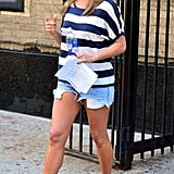 Gray wedges amped up a stripe tee and denim shorts look in July 2013.