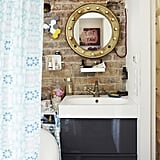 By mounting small, open cabinets on her bathroom wall, Éléonore can easily keep track of her beauty products and toiletries.