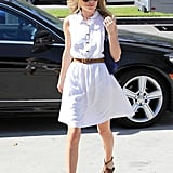 Kate Bosworth paired her outfit with brown sandals.