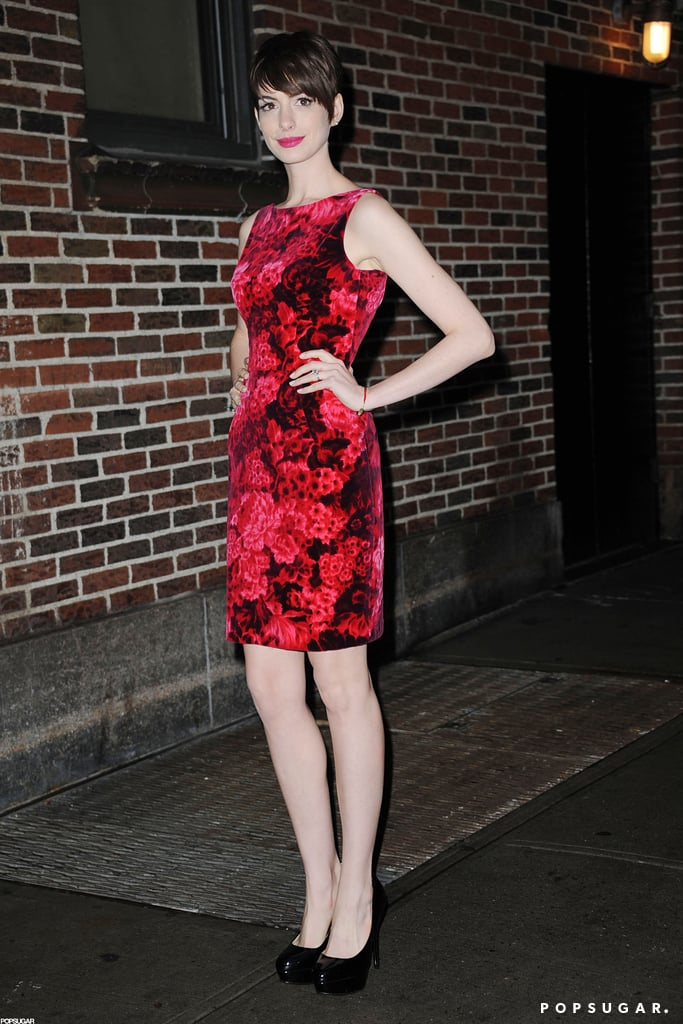 "Anne Hathaway looked ladylike in a red floral dress as she arrived at the Ed Sullivan Theater in NYC last night. She was there for an appearance on The Late Show to chat up Les Misérables ahead of its Christmas Day release. Anne and David Letterman chatted about her weight loss for the role with Anne joking that, ""It wasn't so Fantine would look hot."" After wrapping up the interview, Anne changed into a more dramatic look for the latest Les Mis premiere. Anne wore a black Tom Ford gown and strappy gladiator heels on the carpet. She had a slight wardrobe malfunction, though, and accidentally flashed photographers while exiting her car."