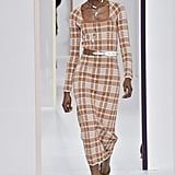 We can imagine Melania adding a body-conscious checked dress like this one to her wardrobe. She'd probably cinch her waist with a similar belt and slip into Manolo Blahnik pumps.