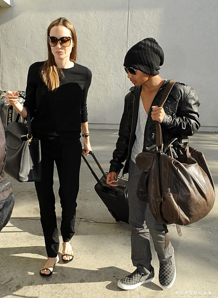 Maddox Jolie-Pitt was a mini version of his dad, Brad Pitt, as he arrived in LA with mom Angelina Jolie.