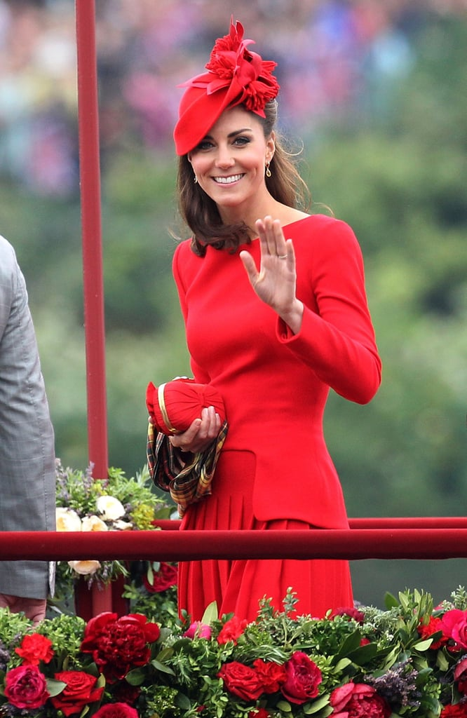 Kate's statement red echoed the hues of the gorgeous rose bushes around her.