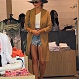 While Chrissy Wore Hers Shopping, Pairing Her White Top With a Duster, a Hat, and Some Denim Shorts