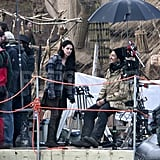 Kristen Stewart stayed warm in a plaid jacket on the set of Snow White and the Huntsman.